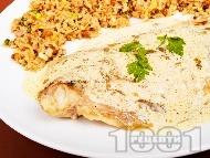 Печено филе от акула с лимонов сос и гарнитура от кафяв ориз с орехи на фурна